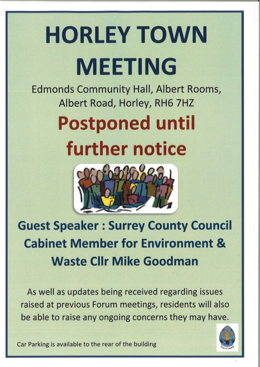 A poster annoucing that the Town Meeting is postponed until further notice