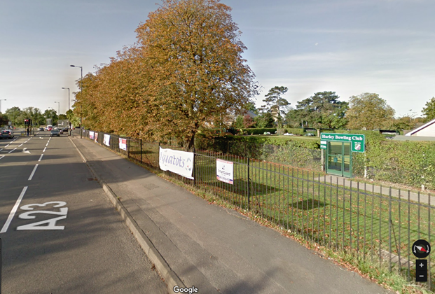 Google Maps street view image of the railings alongside the Horley Recreation Ground, with banners clearly visable